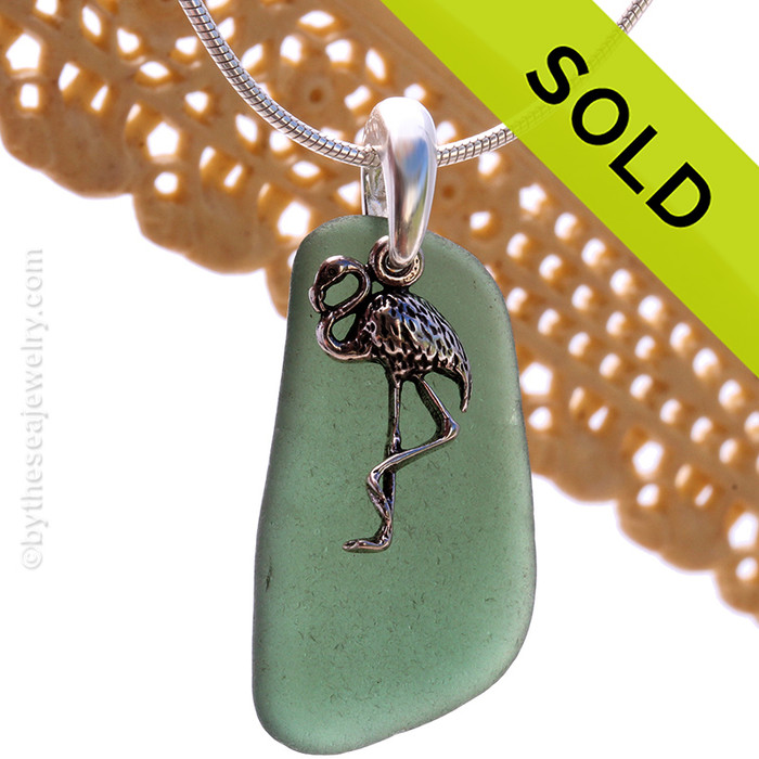 A perfect piece of olive or jungle green sea glass is combined with a solid sterling starfish and presented on an 18 Inch solid sterling snake necklace chain. Sorry this Sea Glass Necklace has been SOLD!