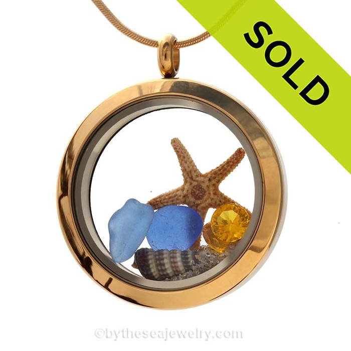 A stunning goldtone stainless steel locket necklace with blue sea glass pieces, starfish and a topaz gem for November birthdays. Sorry this Sea Glass Jewelry selection has been SOLD!