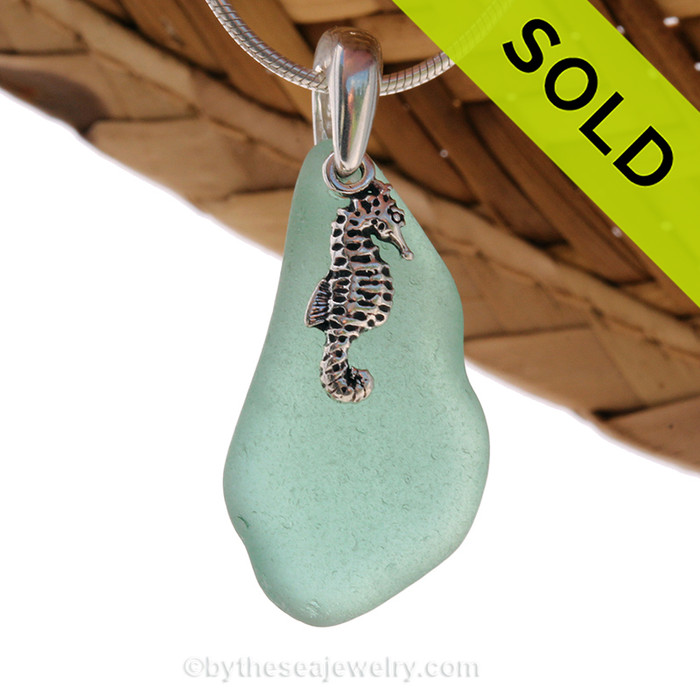 A larger piece of aqua sea glass and searhorse charm on a solid sterling cast bail and presented on an 18 Inch solid sterling snake necklace chain. Sorry this Sea Glass Necklace has been SOLD!