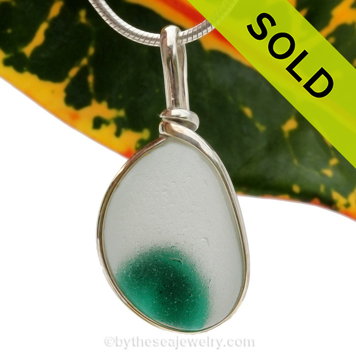 SOLD - Sorry this Ultra Rare Sea Glass Pendant is NO LONGER AVAILABLE An amazing vivid green in a pure white base. This piece was once the tip of a punty or pontil rod used to gather and work glass in the kiln. The color being worked was the rich amber at the bottom.