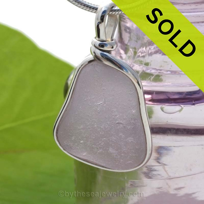 A top quality pale purple or lavender sea glass from Maine in our Original Wire Bezel Pendant Setting© that leaves the sea glass UNALTERED from the way it was found on the beach.  SOLD - Sorry this Rare Sea Glass Pendant is NO LONGER AVAILABLE!
