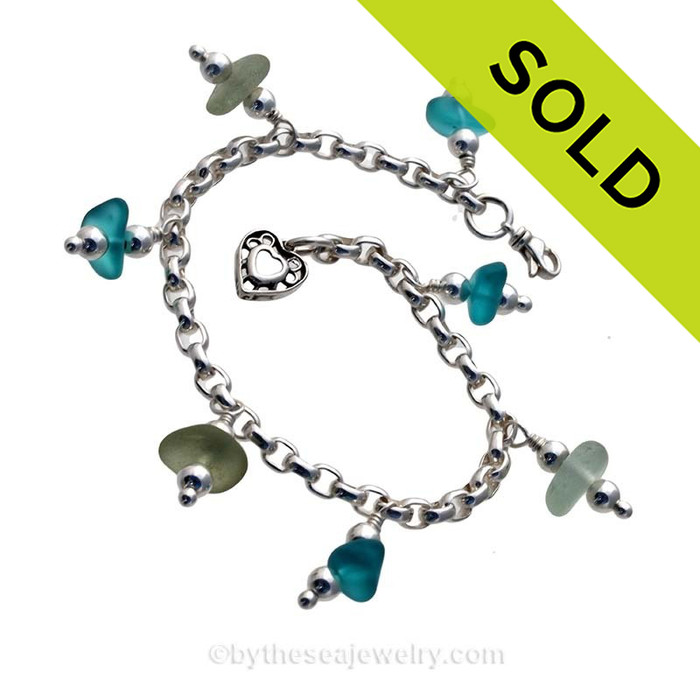 3 pieces of Seafoam Green genuine beach found sea glass combined with vivid bright aqua glass beads in a totally solid sterling silver bracelet. SOLD - Sorry this Sea Glass Charm Bracelet is NO LONGER AVAILABLE!