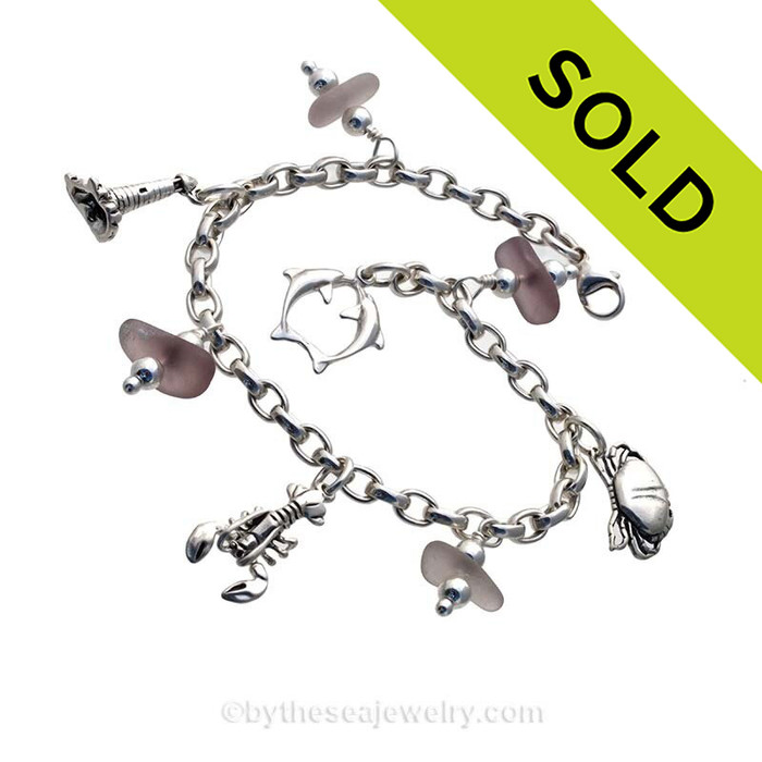 4 pieces of mixed rare lavender genuine beach found sea glass combined with solid sterling beach inspired charms in a totally solid sterling silver bracelet.