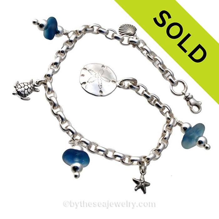 3 pieces of Flashed Vivid Aqua genuine beach found sea glass combined with solid sterling beach inspired charms in a totally solid sterling silver bracelet. Sorry this Sea Glass Jewelry piece has been SOLD!
