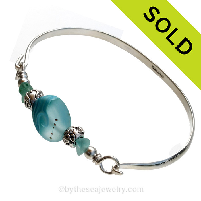 Two pieces of beach found sea glass in vivid tropical aqua on this solid sterling silver half round sea glass bangle bracelet.  Sorry this Sea Glass Jewelry selection is NO LONGER AVAILABLE.