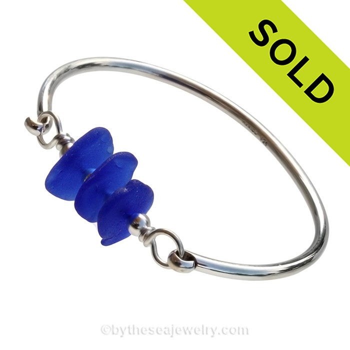 Three pieces of beach found Genuine Sea Glass in vivid cobalt on this solid sterling silver full round sea glass bangle bracelet. This is finished in solid sterling beads. SOLD - Sorry this Sea Glass Bangle Bracelet is NO LONGER AVAILABLE!