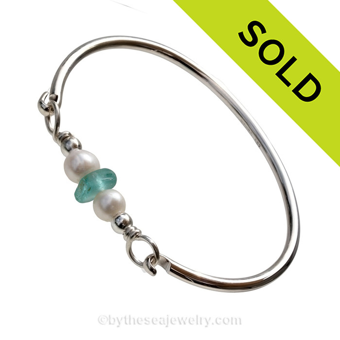 Vivid aqua beach found sea glass combined with real cultured pearls on this solid sterling silver round sea glass bangle bracelet.  SOLD - Sorry this Sea Glass Bangle Bracelet is NO LONGER AVAILABLE!