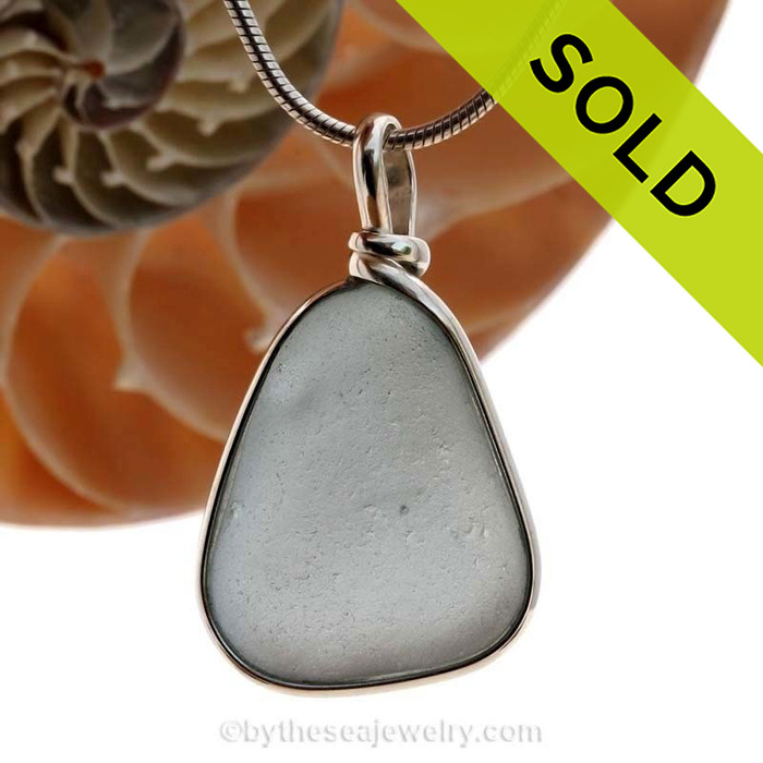 A stunning gray blue sea glass set in our Original Wire Bezel© necklace pendant setting in Solid Sterling. SOLD - Sorry this  Rare Sea Glass Necklace is NO LONGER AVAILABLE!