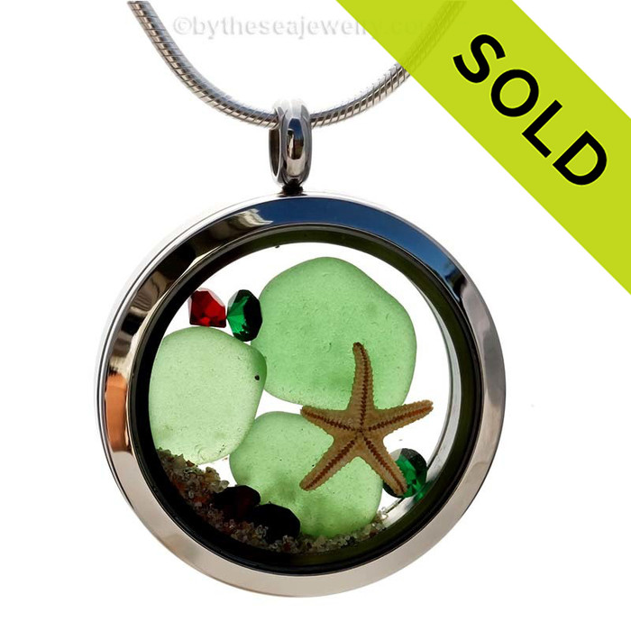 Green Genuine beach found sea glass and a real starfish and beach make this a great locket necklace for the holidays. Ruby and Deep Green crystal gems finish the locket with some extra bling. SOLD - Sorry this Sea Glass Locket is NO LONGER AVAILABLE!