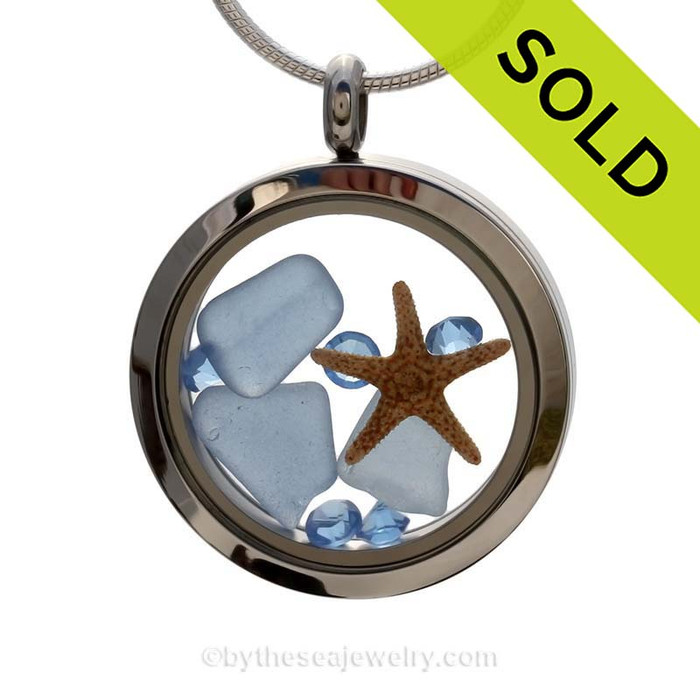 A beautiful pieces of natural Carolina blue sea glass combined in a stainless steel locket necklace with a real starfish and light blue crystal gems.  SOLD - Sorry this Sea Glass Jewelry selection is no longer available.