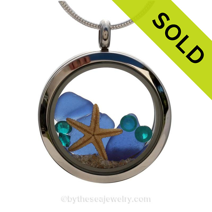 A beautiful pieces of Genuine Blue Sea Glass combined in a stainless steel locket necklace with a real starfish. Sorry this Sea Glass Jewelry selection has been SOLD!