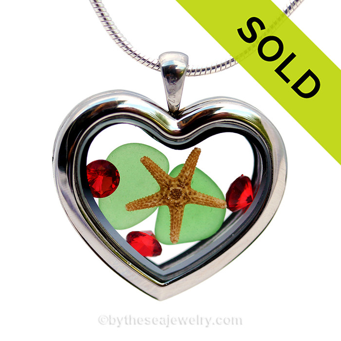Our new heart lockets make this green sea glass really shine! A tiny starfish and red crystals gems make this a perfect holiday treat! Sorry this Sea Glass Locket is no longer available.