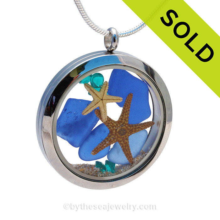 Vivid aqua gemstones, real Blue Sea Glass and two real starfish are snug inside this one of a kind sea glass locket necklace. SOLD - Sorry This Sea Glass Jewerly Selection Is NO LONGER AVAILABLE!