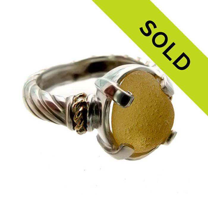 Great piece of all natural golden sea glass in a beautiful sterling silver ring setting with 14K gold accents. SORRY THIS RING HAS BEEN SOLD!