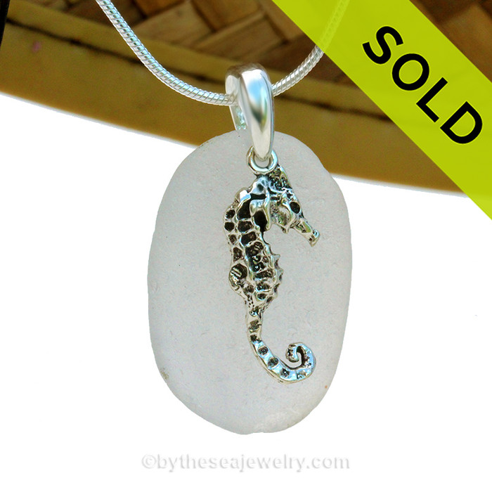 A perfect round and frosty piece of pure white sea glass is combined with a solid sterling LARGE Seahorse charm and presented on an 18 Inch solid sterling snake necklace chain.