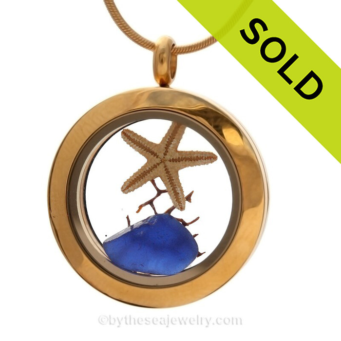 Genuine Blue Sea Glass combined with a baby starfish and bit of seafan in this Mini Locket Necklace Goldtone Stainless Steel Locket Necklace. SOLD - Sorry this Sea Glass Jewelry selection is NO LONGER AVAILABLE!