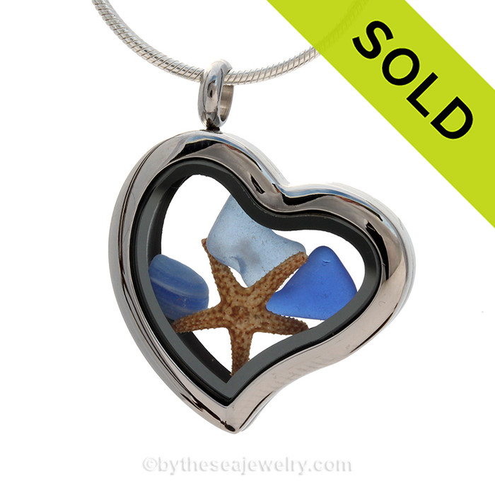 Cobalt Blue , Carolina Blue and a mixed Endoday English blue sea glass combined a large silver heart locket necklace with starfish.