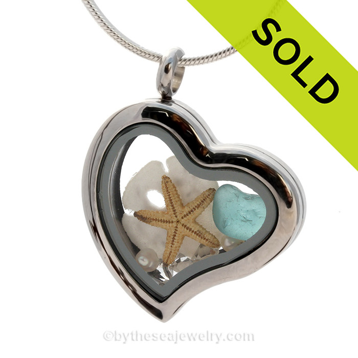 Aquamarine Beach Found  Sea Glass combined a silver Heart Locket necklace with Sandollar, Pearls and CZ Crystal Gems. SOLD - Sorry This Sea Glass Jewelry Selection Is NO LONGER AVAILABLE!