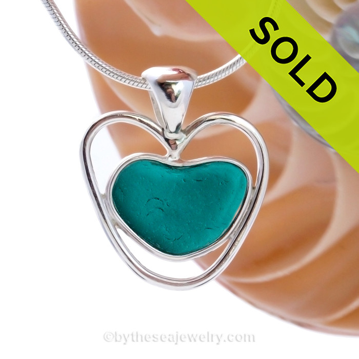 A beautiful small natural sea glass heart set in our deluxe wire bezel pendant setting!  Genuine sea glass hearts are a RARE phenomena and cherished among sea glass lovers! Sorry this one of a kind Sea Glass Necklace has been SOLD!