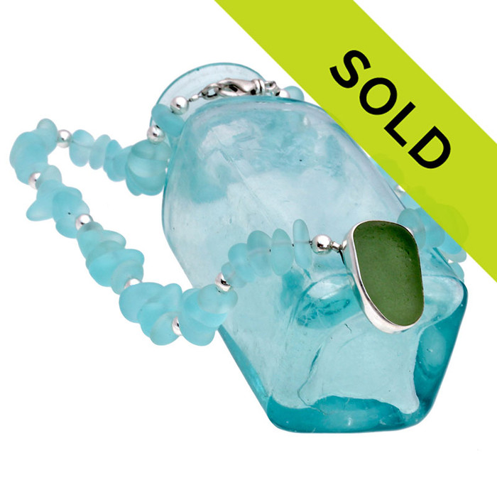 This Vivid Seafoam Sea Glass In Fine Silver Set On Aqua Beads has been sold!