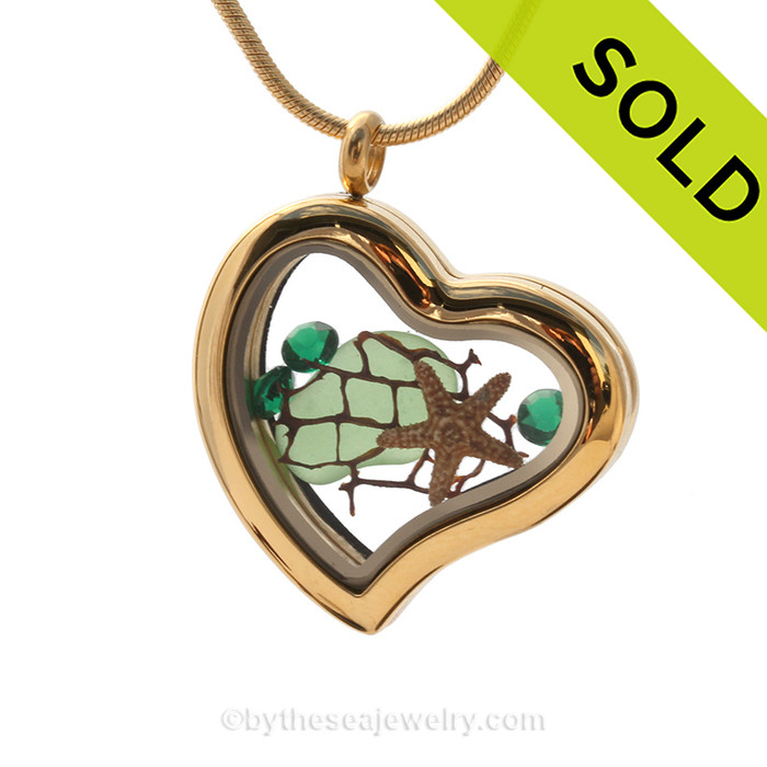 A goldtone stainless steel locket with beach found Green Sea Glass, a real baby starfish and a bit of vintage seafan. Finished with emerald Green Crystal gems. SOLD - Sorry this Sea Glass Locket is NO LONGER AVAILABLE!
