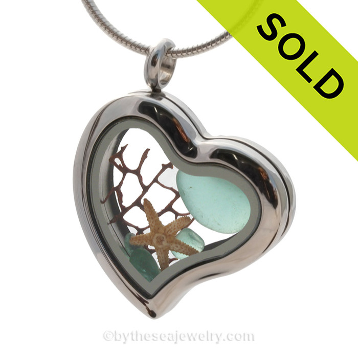 Our new heart lockets make this aqua sea glass really shine! Free Floating and changing like the tide, this piece includes genuine aqua sea glass, a baby starfish.