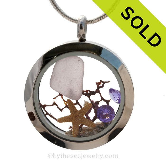 Purple sea glass heart combined with beach sand ,a real starfish and brightened up with an amethyst crystal gem makes this a great choice for a February Birthday!