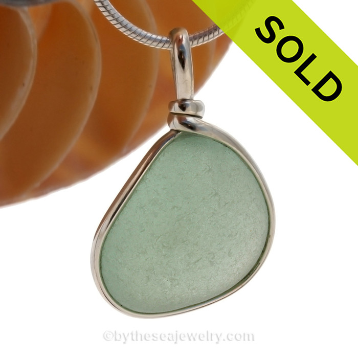 A perfect piece of beach found glass set in our Original Wire Bezel© pendant setting. SOLD - Sorry this Sea Glass Pendant is NO LONGER AVAILABLE!