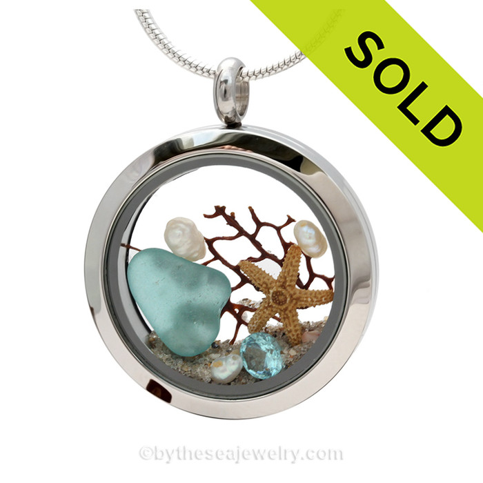 """Beautiful piece aqua genuine sea glass piece combined with a real starfish. Finished with a vivid brilliant cut aquamarine gem and freshwater pearls. SOLD - Sorry this Sea Glass Locket is NO LONGER AVAILABLE! Comes with a Free PLATED 18 """" Chain (not shown)."""