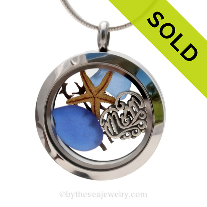 Pieces of Genuine Sea Glass in Blue , a real baby starfish, a bit of vintage sea fan and a Solid Sterling MOM charm completes this sea glass locket necklace. SOLD - Sorry this Sea Glass Locket is NO LONGER AVAILABLE!