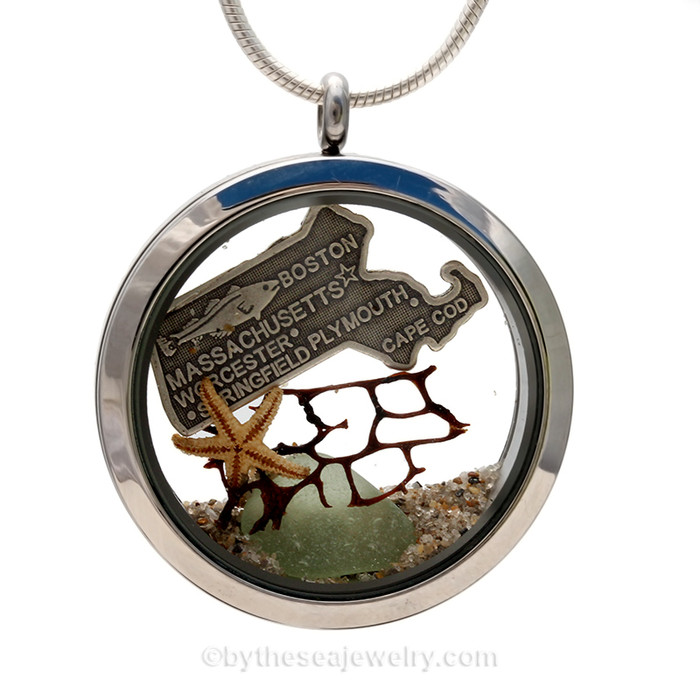 A Beautiful piece of Green Genuine sea glass combined with a real starfish, seafan and a solid sterling Massachusetts State Charm. Finished with real beach sand  in this JUMBO 35MM stainless steel locket necklace.