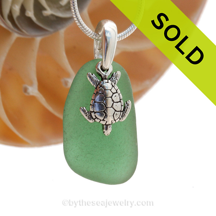 Unusual Green sea glass set on a solid sterling cast bail with a sterling silver Sea Turtle charm. SOLD - Sorry this Sea Glass Necklace is NO LONGER AVAILABLE!