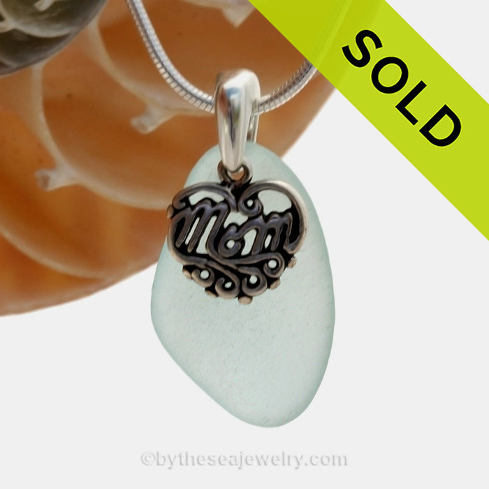 A beautiful and PERFECT beach found aqua sea glass necklace set on a solid sterling cast bail with a sterling silver mom charm