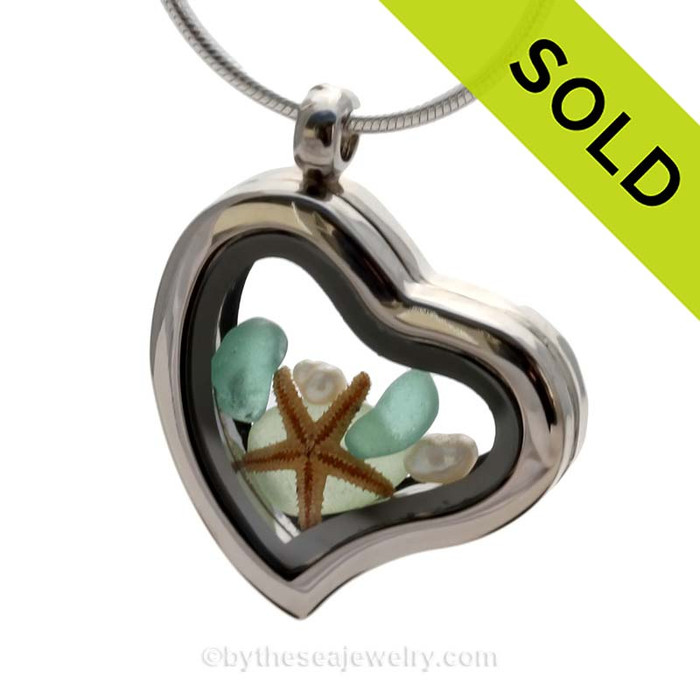 Beautiful pieces of Seafoam Green sea glass pieces combined with a real starfish. Finished with genuine Fresh Water Pearls in this Genuine Sea Glass Heart Locket Necklace. SOLD - Sorry this Sea Glass Locket is NO LONGER AVAILABLE!