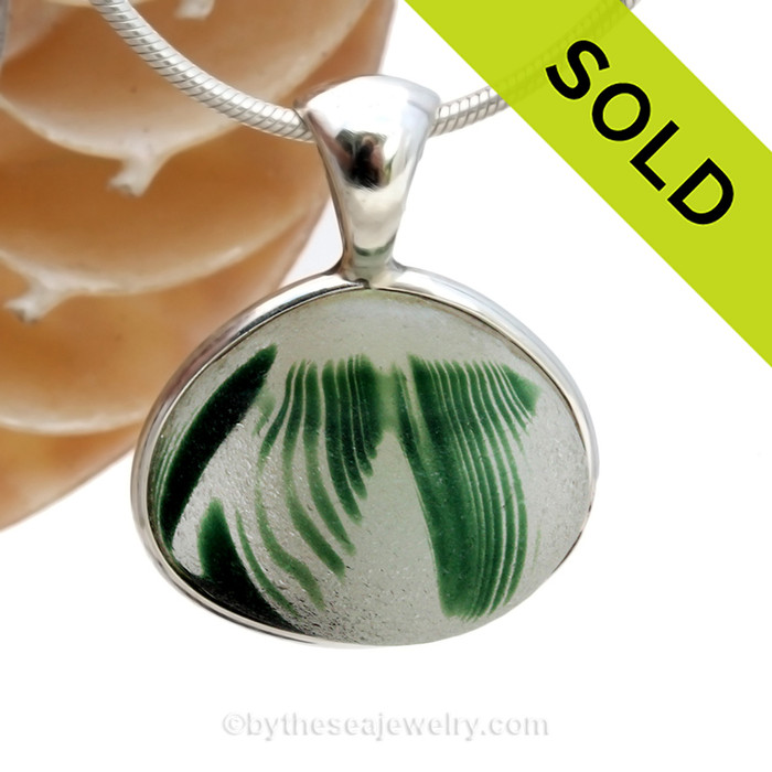 STUNNING beach found Sea Glass from Lundberg Art glass Scraps set in our Deluxe Sterling Wire Bezel© setting in Sterling Silver. SOLD - Sorry this Ultra Rare Sea Glass Pendant is NO LONGER AVAILABLE
