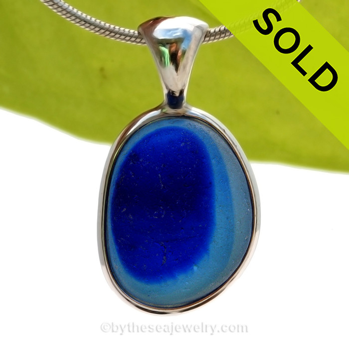 This is a stunning and Large Hypnotic Rich Aqua Blue Mixed English Multi sea glass set for a necklace in our Original Sea Glass Bezel© in solid sterling silver setting. SOLD - Sorry this Ultra Rare Sea Glass Pendant is NO LONGER AVAILABLE!