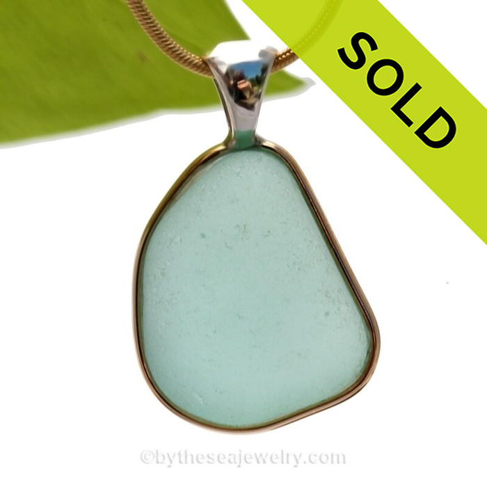 This is a beautiful large  Paler Aqua Green Genuine Sea Glass set in our Mixed Deluxe Tiffany Wire Bezel© pendant setting .