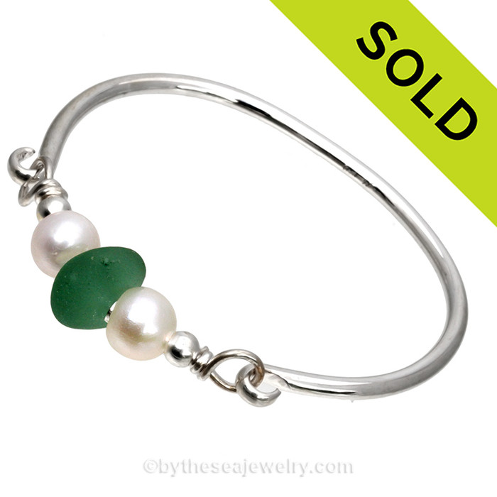 Perfect Aqua Green English Sea Glass combined with real cultured pearls on this Solid Sterling Silver Full round Sea Glass Bangle Bracelet.