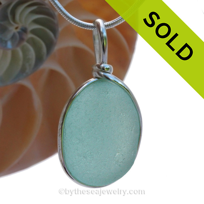 A LARGE piece of natural Aqua Blue Genuine Sea glass in my Original Sterling Silver Wire Bezel© a simple design that lets all the beauty of this glass shine.