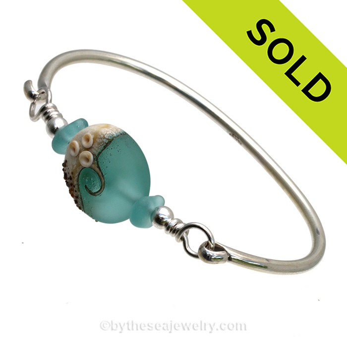 VIVID Aqua Genuine Sea Glass Bangle Bracelet set with a handmade lampwork glass wave bead in aqua with sterling end beads on a solid sterling full round premium bangle bracelet. SOLD - Sorry this Sea Glass Bangle Bracelet is NO LONGER AVAILABLE!