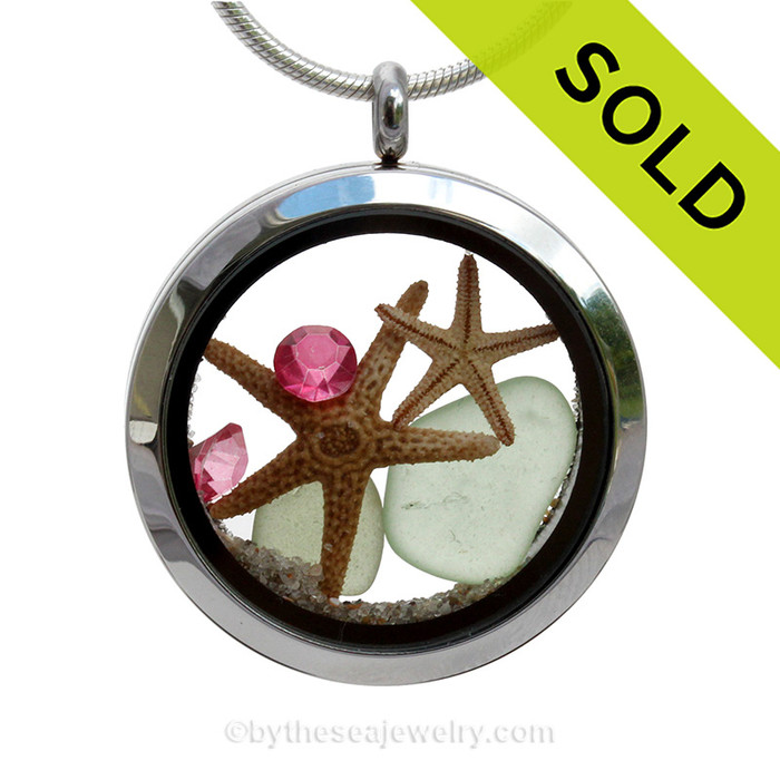 Genuine soft Sea Water Green sea glass pieces combined with a two real starfish and crystal pink tourmaline gems for an October stainless steel locket. SOLD - Sorry This Sea Glass Jewelry Item is NO LONGER AVAILABLE!