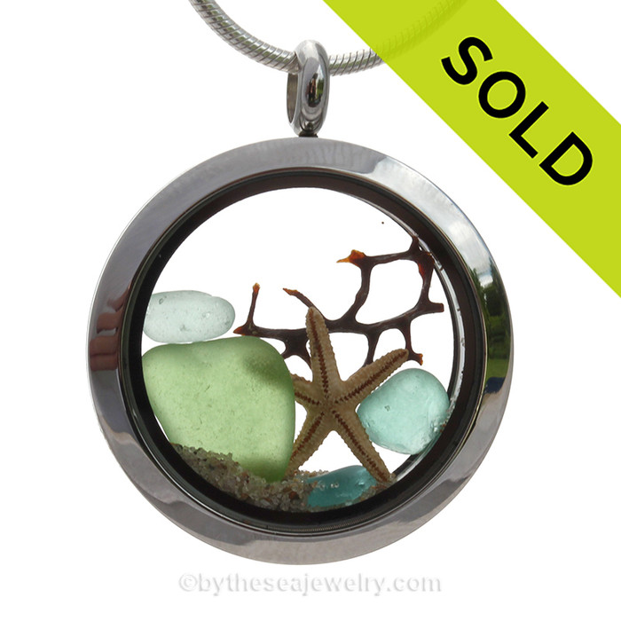 Genuine Green and Aqua Sea Glass Pieces combined with a real starfish in a twist top Stainless Steel Locket Necklace. SOLD - Sorry this Sea Glass Jewelry Selection is NO LONGER AVAILABLE!