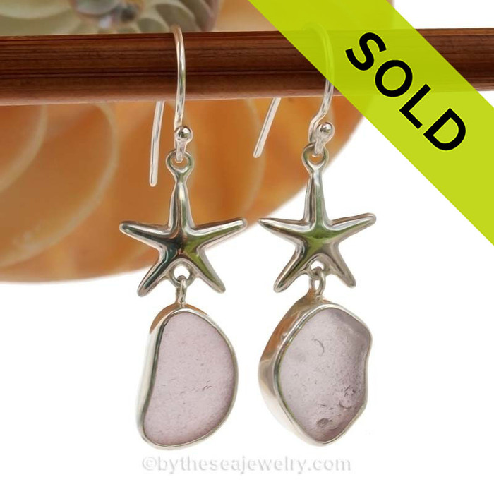 A stunning pair of medium Lavender or Purple sea glass earrings set in a finely crafted setting in sterling silver. Once in a lifetime pair!
