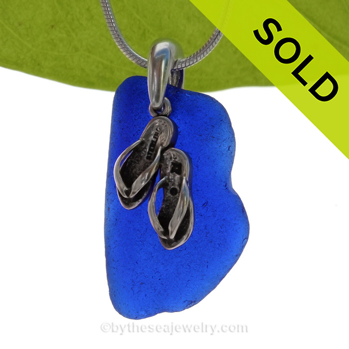 A curvy Rare Cobalt Blue beach found Sea Glass Necklace set on a Solid Sterling cast bail with a sterling silver Starfish Charm.