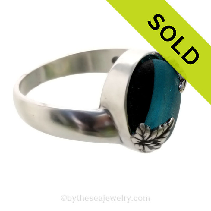 A stunning piece of Victorian Era Electric Aqua and Black Sea glass Ring in a secure Solid Sterling ring.