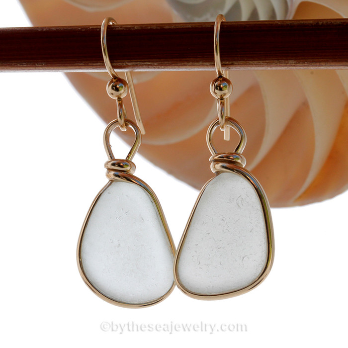 Larger and thinner natural UNALTERED white sea glass set in our Original Wire Bezel© setting.
