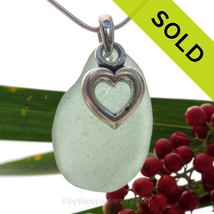 A beautiful and PERFECT beach found Seafoam Green  sea glass necklace set on a solid sterling cast bail with a sterling silver puffy Heart charm.