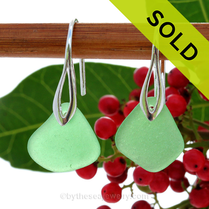 Simple beach found green sea glass pieces on solid sterling silver deco hooks.