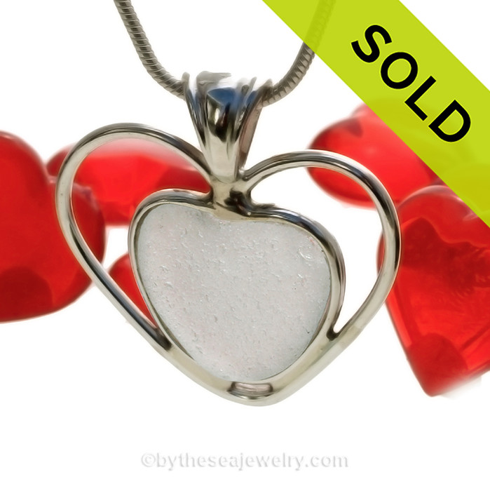 A beautiful and rare  pure white natural sea glass heart set in our deluxe wire bezel pendant setting!  Genuine sea glass hearts are a RARE phenomena and cherished among sea glass lovers! SOLD - Sorry this Rare Sea Glass Pendant is NO LONGER AVAILABLE!