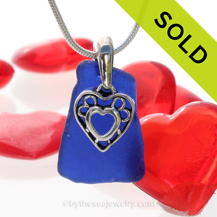 A  nice cobalt bluen genuine sea glass with a solid sterling bail and detailed heart in heart charm. This piece comes complete with our sterling 1.2 MM snake chain. SOLD - Sorry this  Rare Sea Glass Necklace is NO LONGER AVAILABLE!